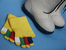 Valenoks and gloves. Children's valenoks and gloves Stock Photo