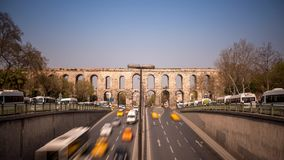 Valens Aqueduct Istanbul. Time Lapse of traffic at the streets of Istanbul in front of the Valens Aqueduct stock video footage