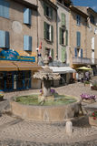 Valensole - central square with fountain and private shops Royalty Free Stock Image