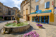 Valensole - central square with fountain and private shops Stock Photography