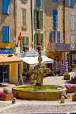 Valensole - central square with fountain and private shops Stock Photos