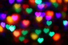 Valentijnskaarten Kleurrijk hart-vormig bokeh op zwarte verlichting als achtergrond bokeh voor decoratie bij de valentijnskaart v royalty-vrije stock fotografie