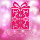 Valentin dag. Gåva på rosa bokehbakgrund. Arkivfoton