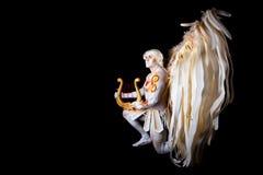 Valentin dag, kupidonman med harpan Royaltyfri Fotografi