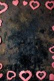 Valentin dagram - rosa hjärtor på svart yttersida Royaltyfria Bilder