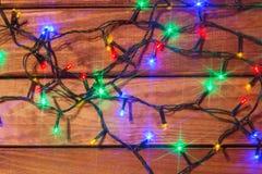Valentin eller romantiska ljus för jul på wood bakgrund Royaltyfria Bilder