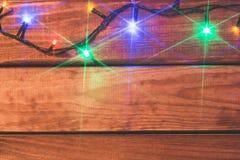 Valentin eller romantiska ljus för jul på wood bakgrund med kopieringsutrymme Arkivfoto