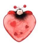 valentin för hjärtanyckelpigared Arkivfoton