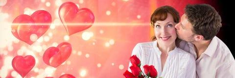 Valentin kopplar ihop att kyssa med förälskelsehjärtabakgrund Royaltyfri Bild
