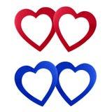 Valentin röda blått för daghjärtor arkivbild