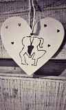 Valentina Day.white vintage heart, a boy with a girl holding hands royalty free stock photography