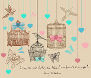 Valentinbakgrund med burar och fåglar Arkivbild