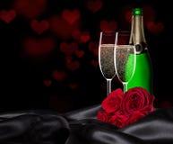 Valentindag med champagne och rosor Arkivfoto