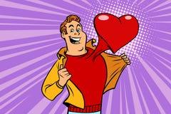Valentindagen, man förälskat med en röd hjärta Royaltyfri Bild