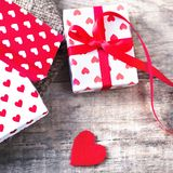 Valentine's Day card with red hearts, gift box with red ribbon Royalty Free Stock Image