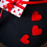 Valentine's Day card with red hearts, gift box with red ribbon Stock Images