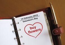 Valentine's Day in a personal organiz. Valentine's Day, 14 February in a personal organizer with buy flowers in a heart Stock Image