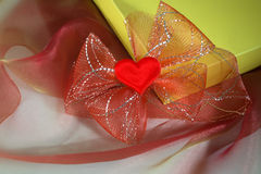 Valentine. Gift with heart and ribbon Royalty Free Stock Photo