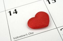 Valentine. Small satin heart on calendar stock image