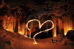 Valentine. The entrance to the ice cave and Valentine heart Stock Photography
