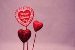 Valentine. Three valentine hearts on a pink background stock images