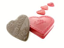 Valentine. Chocolate and foilwrapped hearts stock photos