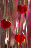 Valentine abstraction. Three hearts on vertical lines Royalty Free Stock Images
