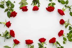 Valentine or Anniversary Red Roses Framed Around Blank Message space for your text or Image. Frame of beautiful red. Bouquete with copy space in the middle stock images
