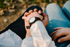 Valentine background closeup couple holding hand sit in park wit Stock Image