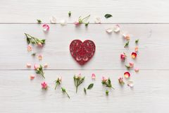 Valentine background with handmade heart shape paper card in pink rose flowers circle on white rustic wood Royalty Free Stock Photos