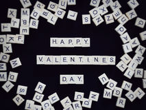 Valentine background : Happy Valentine`s day text from scrabble vector illustration