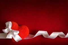 Valentine background - red heart with bow. Border made of red heart with bow and white ribbon royalty free stock photos