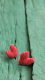 Valentine background, red heart on green wooden Stock Images