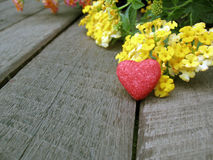 Valentine background,red heart with yellow flowers Stock Images