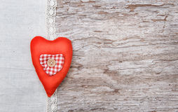 Valentine background  with textile heart on old wood Stock Image