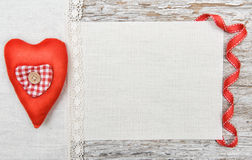 Valentine background  with textile heart and ribbon on old wood Royalty Free Stock Photography