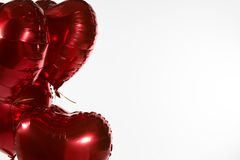 Valentine balloons against white background royalty free stock image
