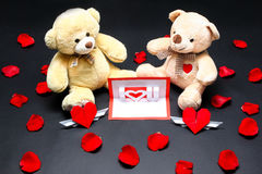 Valentine bears and card. A bear couple with love card Royalty Free Stock Images