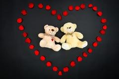Valentine bears in petal heart - Series 1. Bears in rose petal heart Stock Photography