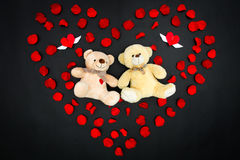 Valentine bears in petal heart - Series 3. Bears in filled rose petal heart Stock Photo