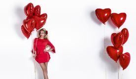 Valentine Beauty girl with red air balloon isolated on white background. Beautiful Happy Young woman presenting products. royalty free stock image