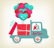 Valentine with bird carrying a gift on the car Stock Photo