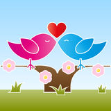 Valentine birds kissing on a tree. A female and a male bird sitting and kissing on a flowered tree at springtime. Vector illustration in EPS 10 with copyspace on Stock Images