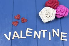 Valentine on a blue background with red hearts royalty free stock photos