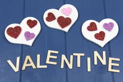 Valentine on a blue background with white hearts royalty free stock image