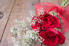 Valentine bouquet of three red roses with white gypsophila flowe Royalty Free Stock Photos
