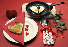 Valentine breakfast with heart shape egg and toast with love hearts Royalty Free Stock Photo