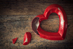 Valentine broken heart on a wooden background Royalty Free Stock Photography