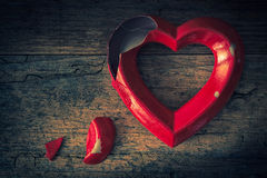 Valentine broken heart on a wooden background Stock Photography