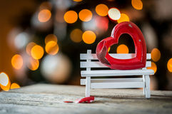 Valentine broken heart on a wooden bench Royalty Free Stock Photos